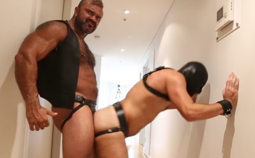 Hairy muscle man Rogan Richards fucks a sub in the hallway