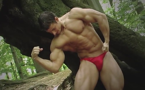 A Pair Of Red Speedos Shows This Bodybuilder's Assets Off
