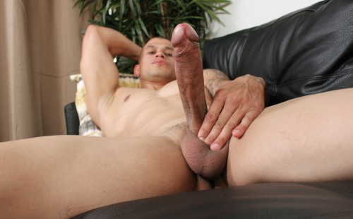 Big muscle stud Rico strokes his fat uncut cock
