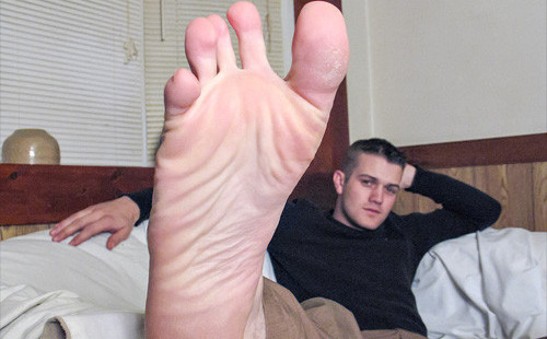 Barefoot Bryce Corbin spreads his toes